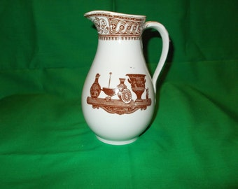 One (1), Water or Milk Pitcher, from Furnivals, of England.