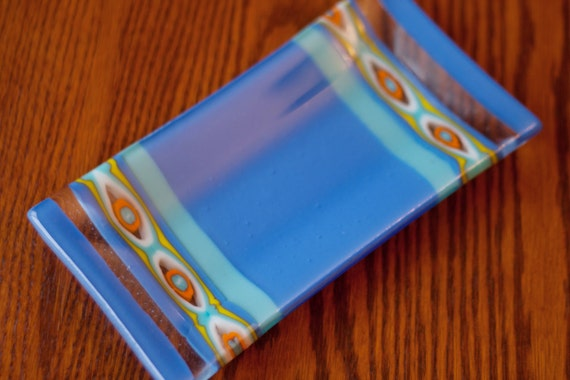 "Periwinkle Blue and Teal Glass Fused 5x10 Rectangle Sushi Plate with orange, white and yellow ""evil eye"" pattern bar"