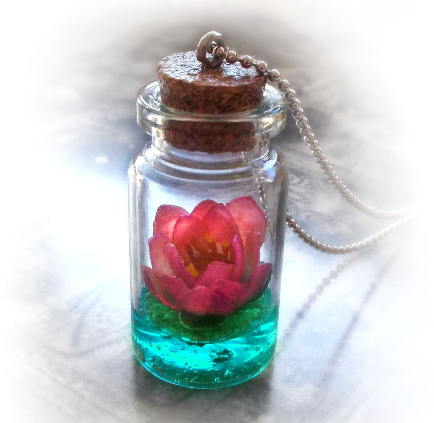 Lotus flower on a magic lake bottle necklace vial by uraniaart for Magis bottle