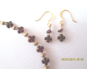 Swiss Cross petite garnet and gold bracelet and earrings