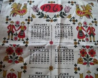 calender dishcloth vintage 1966 folk pennsylvania dutch red gold pink and green  calender linen dishcloth with hem for hanging