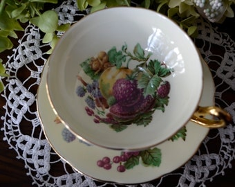 Taylor & Kent Fine Bone China Tea Cup and Saucer, Pale Yellow Fruit, Gold Gilt, England.