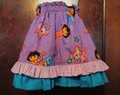 DORA THE EXPLORER ruffled twirly skirt size 2-4.  Lined purple Dora skirt.