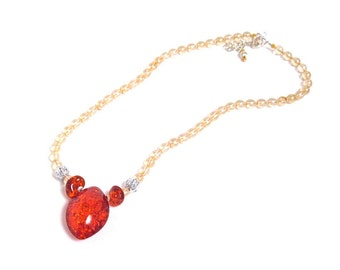 Necklace of champagne luster Czech beads, a pressed amber briolette and two silver filigree beads