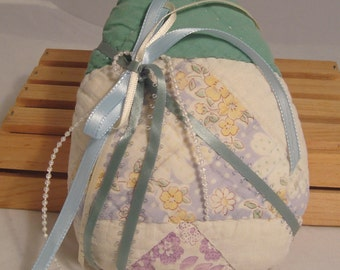 Small Egg-Shaped Decorator Pillow Constructed from Rescued Antique Cutter Quilt