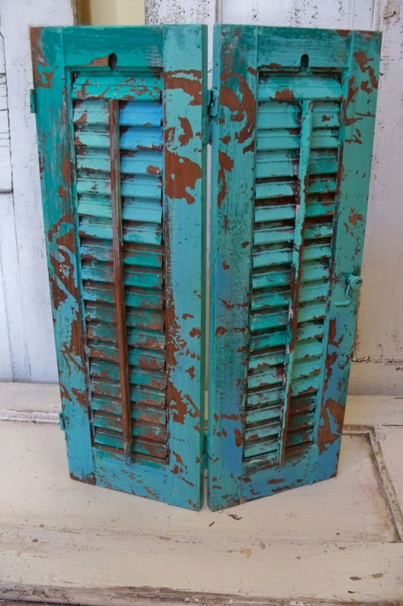 hand painted caribbean turquoise wooden shutter beach cottage