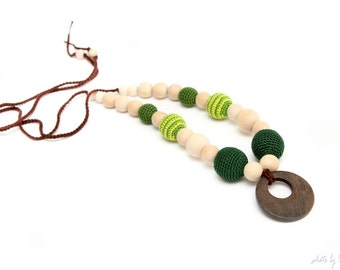 Teething nursing necklace in dark green and striped green colors with wooden ring pendant