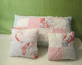 Three little vintage quilted pillows