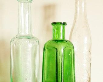 Vintage Bottles, one antique