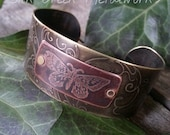 Etched Butterfly Cuff with Spiraling Vines and Brass Rivets