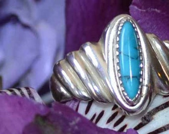 Vintage Polished Sterling Silver and Blue Turquoise Ring with Oblong Stone Circa 1970 size 6 1/2