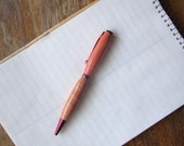 Pink Ivory twist pen, red colored finish
