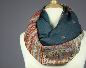 Teal  infinity scarf with a floral , ethnic design  ,