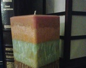burnt orange, sage green and brown triple scented candle with lemon grass, bamboo and balsm spice.