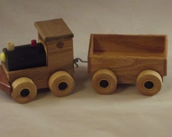 Toy Train wooden 2 pc trailing a open  car. Perfect for youngsters