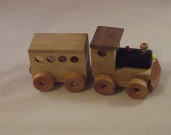 Toy Train wooden 2 pc trailing a closed  car. Perfect for youngsters