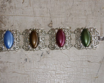 1960s Sarah Coventry CAROUSEL Pattern Silver Tone Bracelet With Different Colored Stones