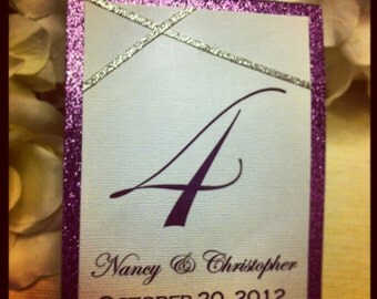 Purple and Silver Glitter Table Numbers for: weddings, sweet sixteens, birthdays, engagement parties, and other events.