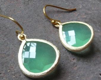 Apple green earrings in gold.