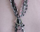 Lanyard, or Scarf with multi colors of light pink, and different shades of grey. (ribbon yarn)