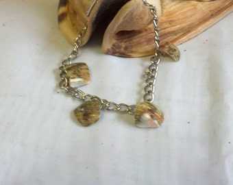 Petite silver tone bracelet with sea shell charms
