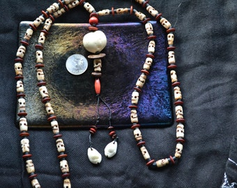 108 bead, Hand Carved Bone Skulls Mala.  Very Pirate-y or Day of the Dead feeling.