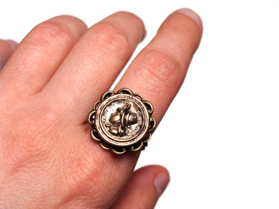 stamped brass portrait button from Victorian era made into jewelry cocktail ring