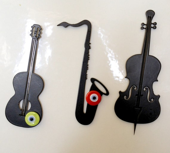 metal cut orchestra musical instruments cello, guitar, saxophone ...