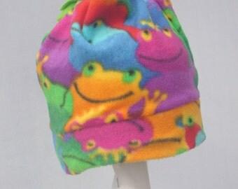 Children's frog patterned fleece hat with green tassle.