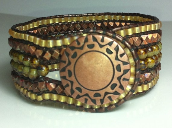 Copper metallic wide leather wrap cuff bracelet.  Wide cuff in earthy green, gold and copper.