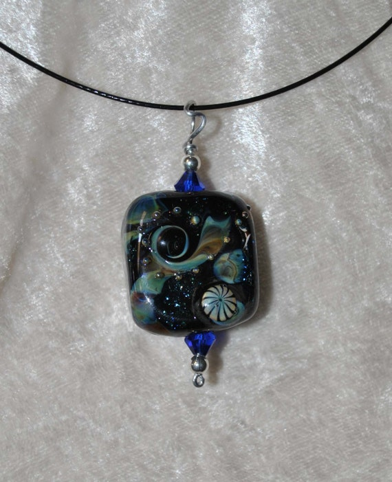 Navy blue focal pendant with dichroic sparkle and a modern design mix