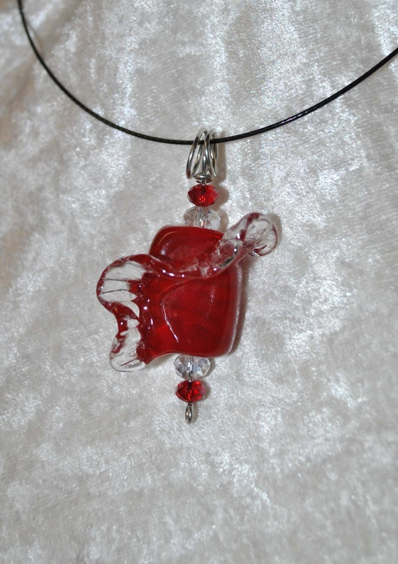 Lampwork Red glass pendant with clear decorative flurish