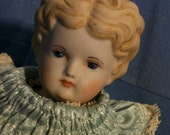 Porcelain  doll,  china head doll, a must have