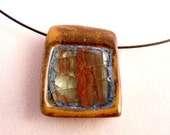 """Simple 1"""" pottery pendant with glass inside the necklace"""