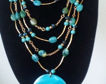 Five strand beaded necklace.