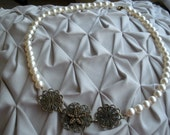 Swarovski pearl necklace with antiqued brass flower accents