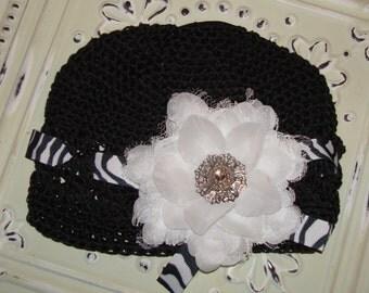 Black and white vintage hat with vintage white flower, zebra ribbon, and rhinestone detail.