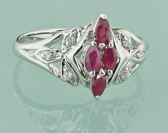 Cute and Fun 14k White gold Marquis shaped Genuine Ruby and Diamond accent Ring
