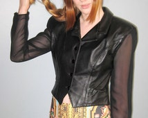 Vintage leather jacket with sheer panel and sleeves. 1980s black leather made by Tannery West, size S