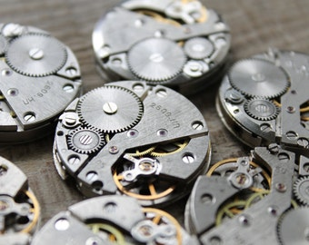 "lot of 10 identical  1""... vintage watch movements"