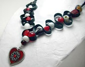 Heart pendant. Red, white, black beaded ribbon necklace. Adjustable length - black ribbon untied. Glass red and white beads.