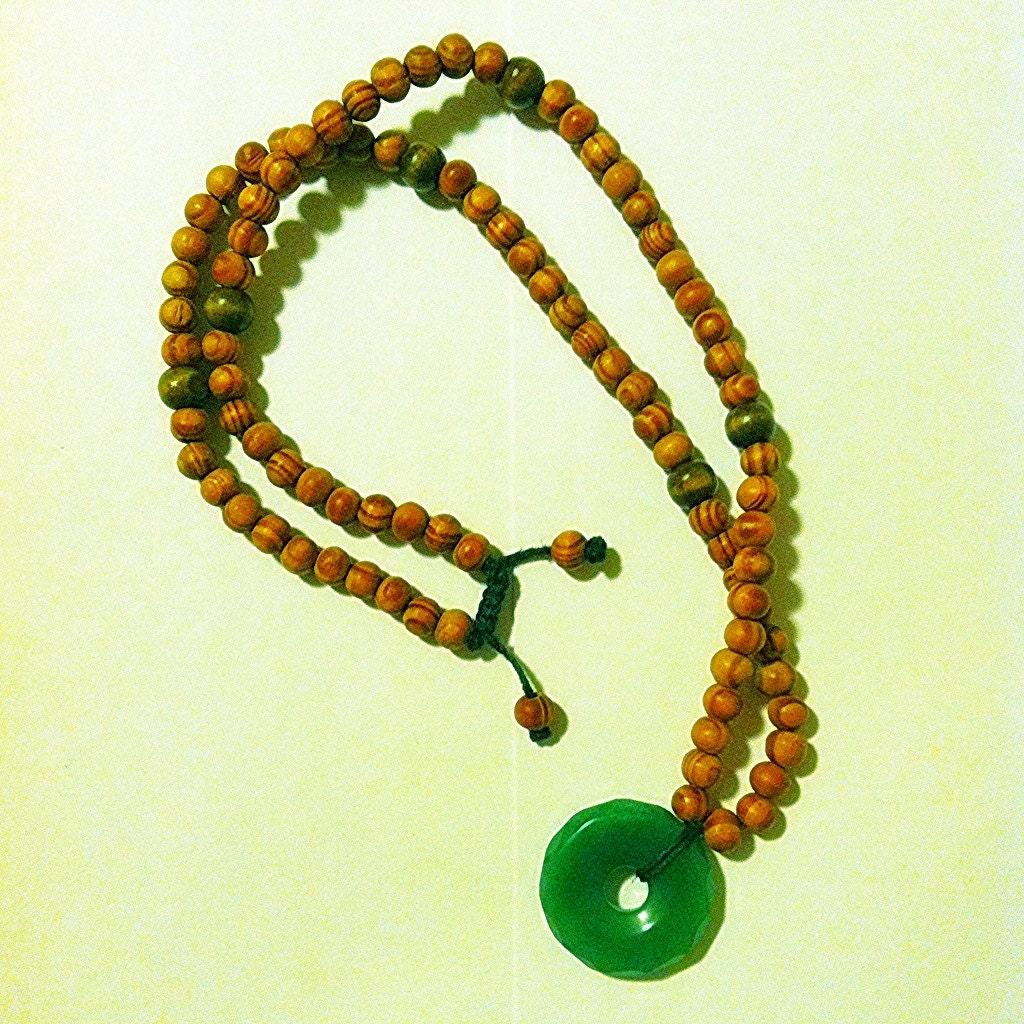 jade faceted donut pendant