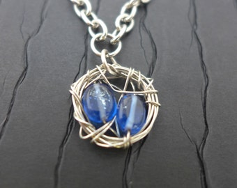 Silver wire nest necklace with blue glass bead eggs...Sale