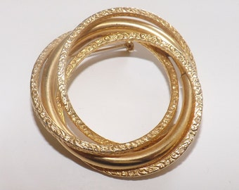 Vintage brooch of large interlocking rings