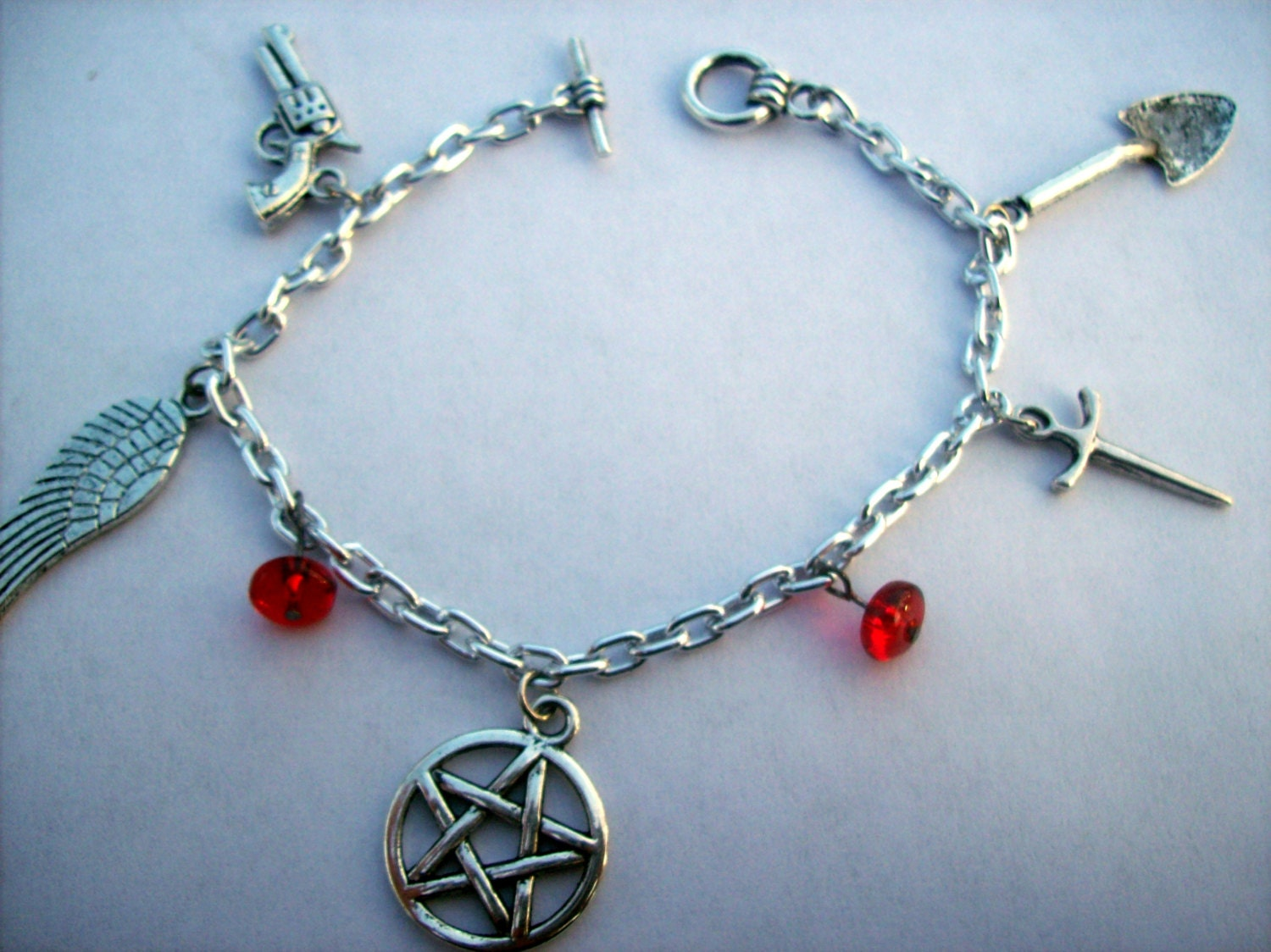 supernatural inspired charm bracelet by jinxyjewels on etsy