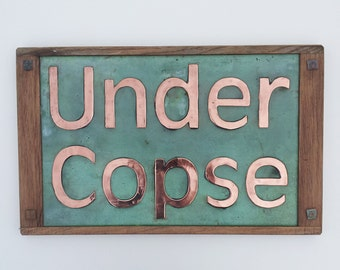 "House Sign in copper 4""/100 mm Antigoni letters with Oak wood frame on  2 x lines CAPS and lower case - maintenance free g"
