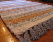 Hand Twined Rag Rug in blues, tans and whites with Hand Tied Matching Fringe.  Free Shipping Coupon Code:   shpoff