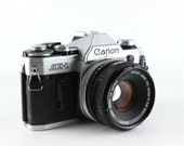 Fully Functional Canon AE-1 Student Camera W/ 50mm F1.8 Lens