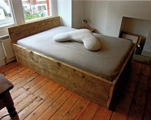 Wooden double bed base with headboard made from solid reclaimed timber