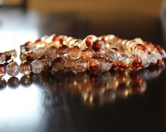 106 approx brown and clear 8 mm crackle glass beads, 1mm hole